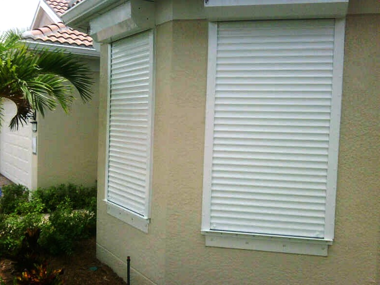 How To Choose Between Hurricane Shutters And Impact Windows To Protect Your Home